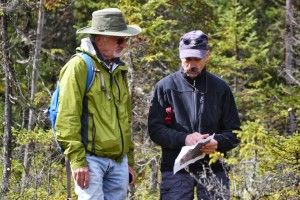 Lem and Dan discussing bog formation next to stunted black spruce, Picea mariana